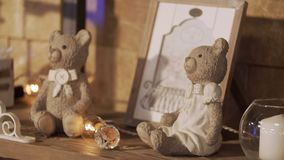 Christmas toy bears. Two bears of toys sit on a fireplace. Two little bears on a fireplace. Festive situation. Cute christmas toy bears. Two bears of toys sit on stock video