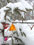 Christmas toy bell at the winter tree Royalty Free Stock Images