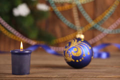 Christmas Toy blue ball and candle Stock Photography