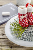 Christmas toy boots. Tree toy in the form of boots on a plate with silver beads Stock Photography
