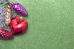 Christmas toy bump and christmas heart shaped red ball on green Stock Photo