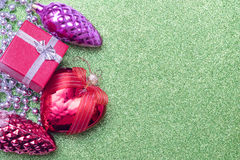 Christmas toy bump, christmas heart shaped red ball and small gift box on background Royalty Free Stock Photos