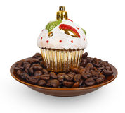 Christmas toy cake on coffee beans in a bowl Stock Photos