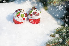 Christmas toy cakes on winter tree and snow Stock Photo