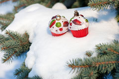 Christmas toy cakes on winter tree with snow Royalty Free Stock Photography