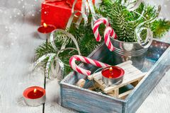 Christmas toy and candy canes Royalty Free Stock Photo
