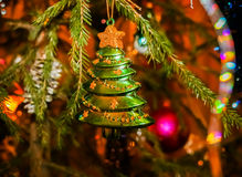 Christmas Toy Christmas tree hanging on green spruce branch. Stock Photos