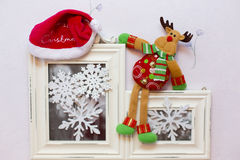 The Christmas toy deer and Santa's cap on Royalty Free Stock Photos