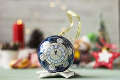 Christmas toy with a dial - midnight, new year, background.  royalty free stock photos