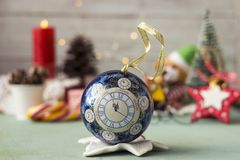 Christmas toy with a dial - midnight, new year, background.  royalty free stock photography