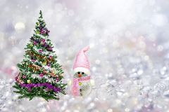 Christmas toy doll,Christmas tree stock photography