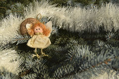 Christmas toy in the form of an angel and a gold sphere Royalty Free Stock Photo