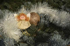 Christmas toy in the form of an angel and a gold sphere Royalty Free Stock Photography