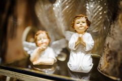 Christmas toy in the form of two cute porcelain praying angels Royalty Free Stock Photo