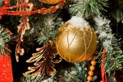 Christmas toy hanging on fir-tree Stock Images
