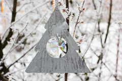 Christmas toy hanging on a tree in winter stock photography