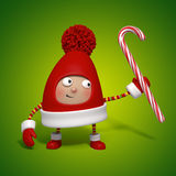 Christmas toy holding candy cane Stock Images