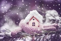 Christmas Toy House Is Wrapped In A Warm Scarf, It`s Snowing.on Royalty Free Stock Image