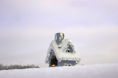 Christmas toy house on the snow. Cozy christmas toy house with candle on the snow Stock Photo
