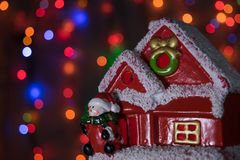 Christmas toy house with a snowman Royalty Free Stock Photography