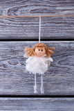 Christmas toy. Little girl fairy. Cute princess on a wooden fence. Christmas toy. Little girl fairy Stock Images