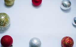Christmas toy, a lot of brilliant balls of golden, silver color and golden tree. New Year. On a gray background stock images
