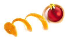 Christmas toy and mandarine skin. Christmas toy. Red beautiful Christmas toy on a white background Stock Photography