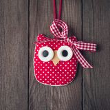 Christmas toy owl on a wooden background royalty free stock photography