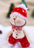 Christmas toy rabbit on background trees Stock Photo