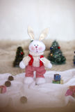 Christmas toy rabbit on background trees Stock Image