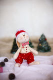 Christmas toy rabbit on background trees Stock Images