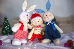 Christmas toy rabbits on the background trees Stock Photo