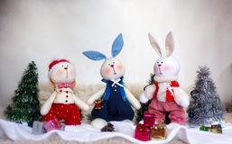 Christmas toy rabbits on the background trees Stock Image