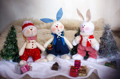 Christmas toy rabbits on the background trees Stock Photography