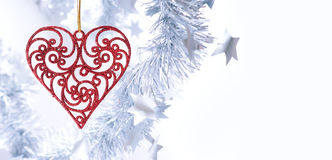Christmas toy. Christmas red heart on white background Royalty Free Stock Photos