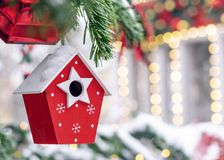 Christmas toy red nesting box on the Christmas tree stock photography