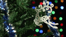 Christmas toy reindeer on the Christmas tree, festive decoration lights. 2017. High quality 10bit footage. Made of 14 bit RAW source stock video footage