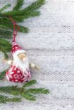 Christmas toy Santa Claus on the background of white knitted fabric royalty free stock photography