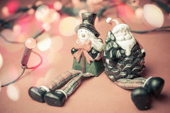 Christmas toy Santa Claus and snowman with garland lights Royalty Free Stock Photo