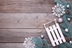 Christmas toy sledge with fir-tree branch on a grey background stock photos