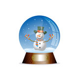 Christmas toy snow globe with a snowman Stock Image