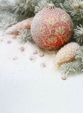 Christmas toy in the snow under the tree. Stock Images