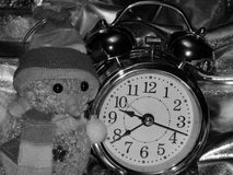 Christmas toy with a snowman and an alarm clock on a black and white image. Close-up stock image