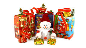 Christmas toy snowman in the middle of gift packages Stock Image