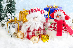 Christmas toy snowman and Santa Claus on snowy background Stock Photography