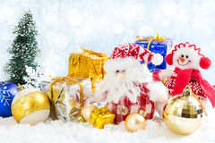 Christmas toy snowman and Santa Claus on snowy background Stock Image