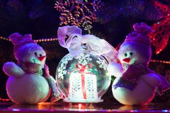 Christmas Snowmen. Christmas Toy Snowmen under the tree Royalty Free Stock Photos