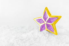 Christmas toy star on the snow Royalty Free Stock Image