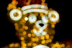 Christmas toy - Statue. Bear. Made of garlands and tinsel, of different colors. It stands near the tree fir. Decoration. royalty free stock photos