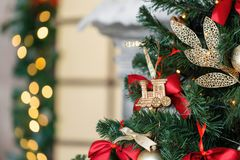 Christmas toy train and garland on the fir tree.  stock photography